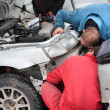 Stockfoto: Two mechanic and white car