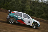 Rally car on dirt gravel track — Stockfoto