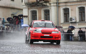 Red rally racecar on wet road — Stock Photo