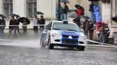 White and blue rally racecar on wet road — Stock Photo