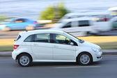 White car on road in city — Stockfoto