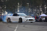 White racing car drifting on road — Stockfoto