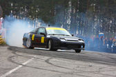 Black racing car drifting on road — Stockfoto