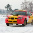 Red and yellow rally car on snow — Stock Photo