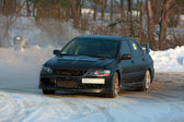 Black rally car on winter racing track — Stockfoto