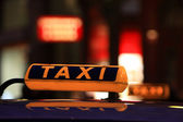 Taxi at night, part of car — Stock Photo