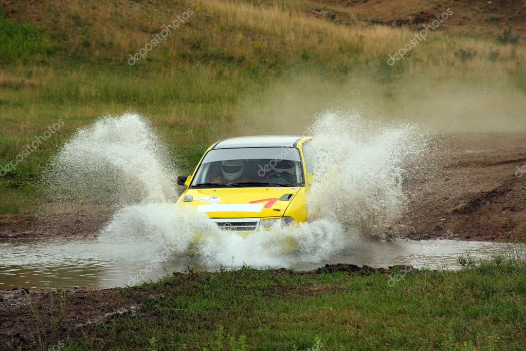 Yellow rally car and water splash  Stock Photo #5241462