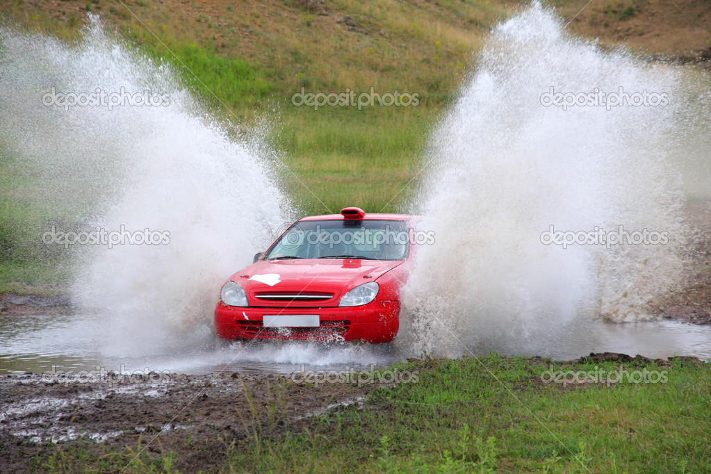 Red rally car and water splash  Stock Photo #5241464