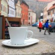 Stockfoto: Old city street, house with windows and cup of coffe