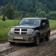 Stockfoto: Black car on dirt road