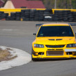 Yellow racecar on track — Stock Photo #5368725