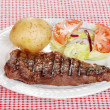 Barbecue steak with salad and baked potato - Stock Photo