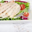 Grilled chicken salad with a fork — Stock Photo