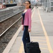 happy woman waiting for a train — Stock Photo