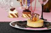 Lemon tart with desserts in the background — Stock Photo
