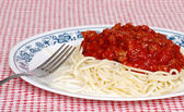 Long noodle spaghetti with meat sauce and a fork — Stock Photo