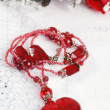 Red heart necklace on lace — Stock Photo
