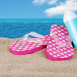 Sandals and suntan lotion on a sunny day — Stock Photo #4266415
