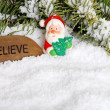 Santa claus and believe stone with snow — Stock Photo