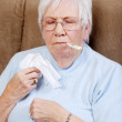 Sick senior taking her temperature — Stock Photo #4267191