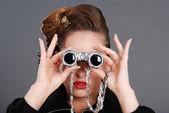 Portrait of woman using fancy binoculars — Stock Photo