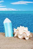 Loción de conchas de mar y sol — Foto de Stock