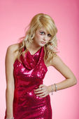 Sexy woman wearing red sequin dress — Stock Photo