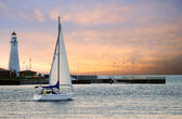 Sailboat leaving marina — Stock Photo