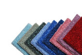 Row of colorful carpet samples — Stock Photo