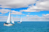 Sail boating on blue water — Stock Photo