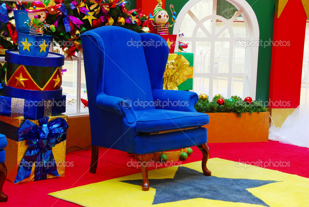 Colorful display of Santa Claus chair in a setting   Stock Photo #4267058
