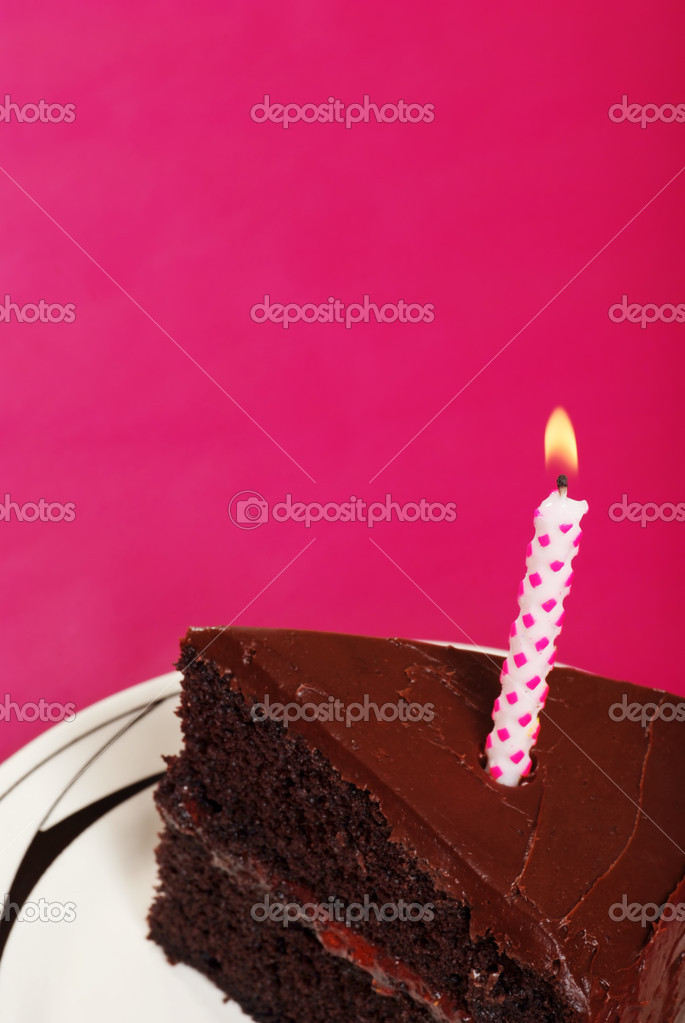 Closeup of slice of birthday cake with copy space focus on wick with pink background  — 图库照片 #4267313