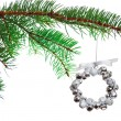 Silver Christmas bell wreath on a branch — Stock Photo