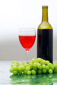 Red with bottle — Stock Photo