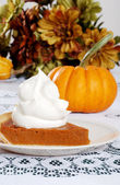 Slice pumpkin pie with lots of whip cream — Stock Photo