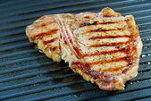 T Bone Steak on a grill — Stock Photo