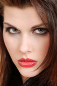 Headshot young brunette woman with red lipstick — Stock Photo