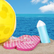 Beach ball sandals and suntan lotion — Stock Photo