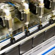 Stock Photo: Bottling process 2