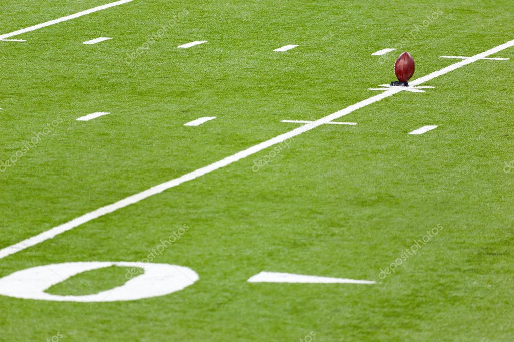 Football on a kicking stand in the  football field — Stock Photo #4683025