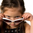 Little girl with sunglasses - Stock Photo
