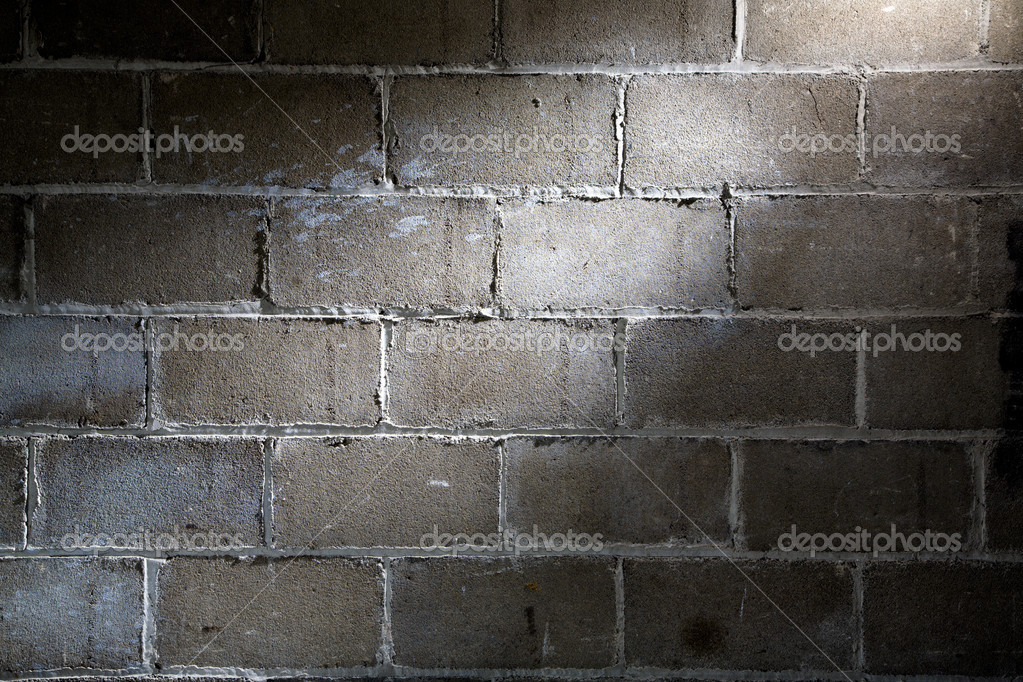 Fragment of block wall with spotlight lighting  Stock Photo #5317617