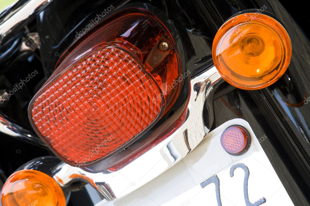 Close-up view of motorcycle rear lights  Stock Photo #5321347