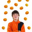 Stock Photo: Boy with oranges