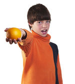 Boy offers orange — Stock Photo