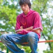 Teenager sitting — Stockfoto