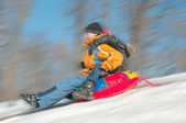 Young Boys Sledding Downhill Together — ストック写真