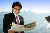 Reading businessman — Stock Photo
