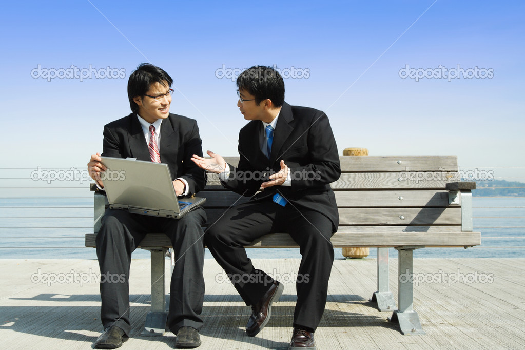Two business partners working together on a laptop — Stock Photo #4010600