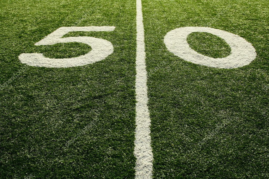 A shot of a 50 yardline at an american football field — Stock Photo #4113554